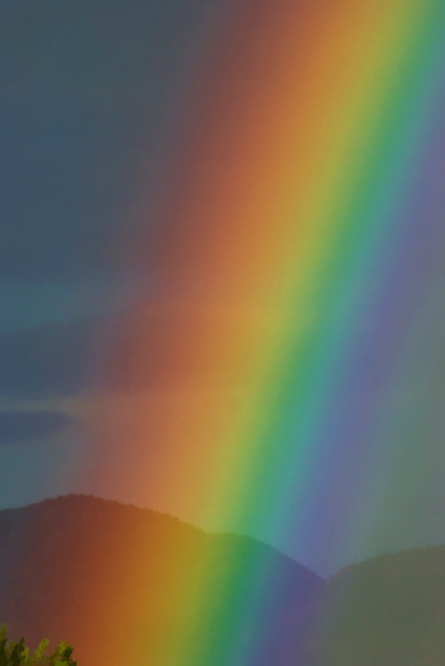 Rainbow, with the Picuris Mountains in the background