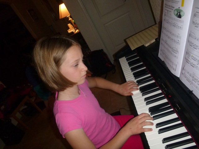 Brooke, at the piano