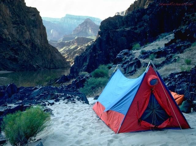 Schist camp, river left at Mile 96.5, has beautiful schist architecture, along with travertine boulders. My old Sierra Designs mountain tent dates this photo.