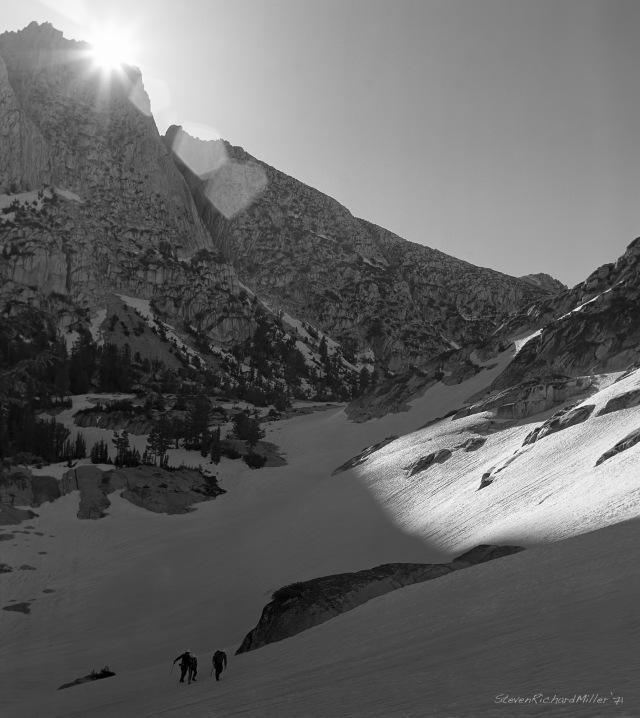 The sun peeks over the shoulder of Ehrnbeck Peak