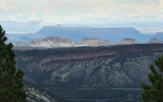 View to the east of Capitol Reef sandstone formations and the Henry Mountains