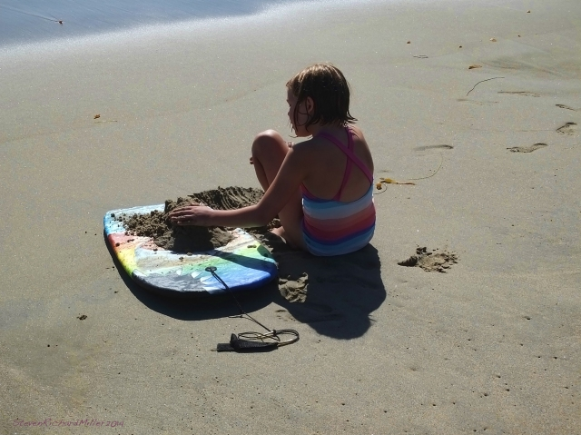 Little girl and boogie board
