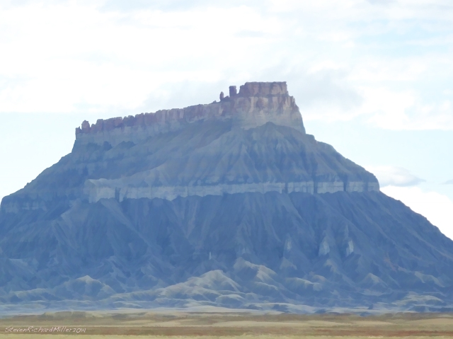 Factory Butte, west of Hanksville. This photo has been processed to resemble a watercolor painting.