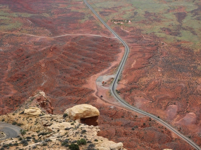 On the Moki Dugway. The dirt road from Valley of the Gods is seen in upper left. A switchback on the Dugway is seen on lower left. The road is paved here.