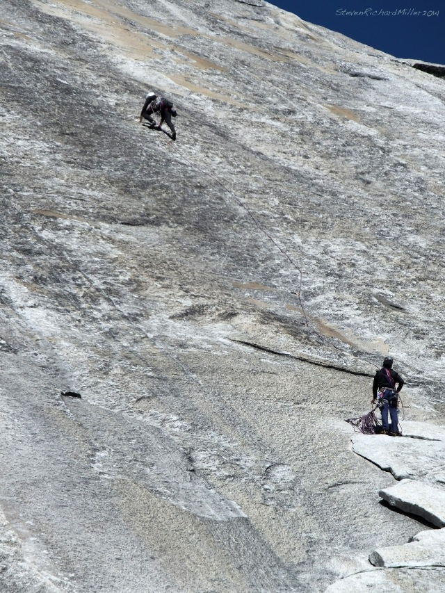 To the left of the great White Book, two climbers on a route that here is protected by bolts