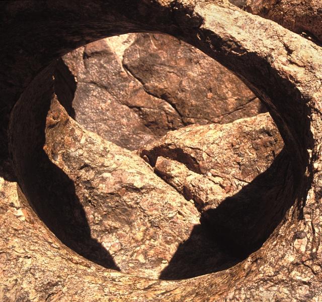 A hole bored into granite, Mile 102 river left