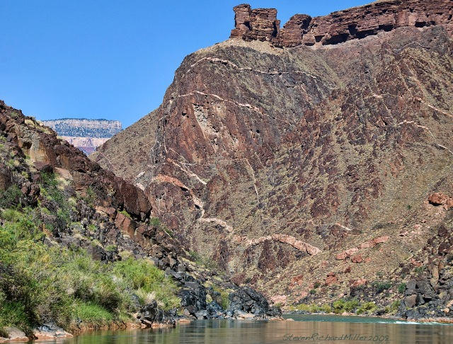 Approaching Emerald Rapid, Mile 103, with a view of the veined Ruby Buttress, topped by towers of the Tapeats