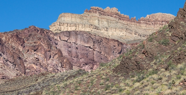 Seen at the mouth of Hotauta Canyon, river right at Mile 107.7, is tilted layers of the Shinumo Quartzite, overlain by another Supergroup rock, the Dox Sandstone. The light-colored ridge seen in the photo belongs to a formation known as the the Dox Castle formation. This is the so-called type locality, meaning the Dox Sandstone was named for its exposure here.