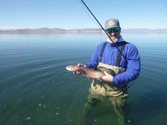 Ethan, with a typical size cutthroat, caught on a Wooly Bugger