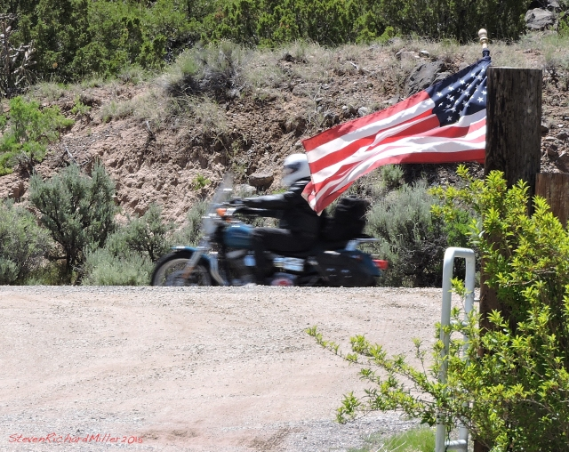 Motorcyclist on Hwy 68 passes our driveway, en route to the Red River Rally