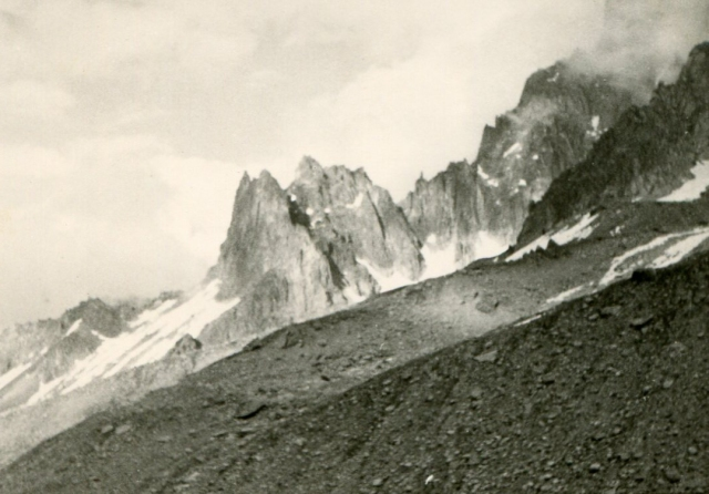 Walking along the base of the moraines, with the Aiguille de L'M seen in the distance. This is a small peak that sits at the foot of the Aig. de Grands Charmoz north ridge, seen to the right.