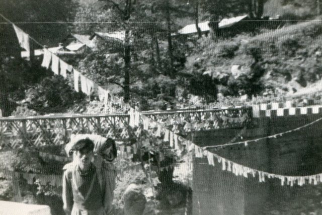 Porter carries my pack into town, Manali, Sept. 1963