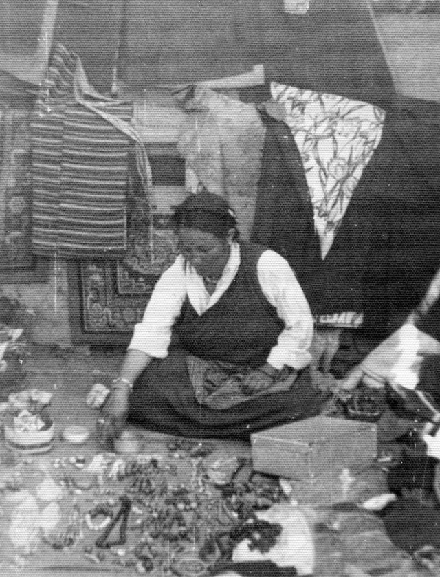 Tibetan woman, selling jewelry. I bought a mounted turquoise from her