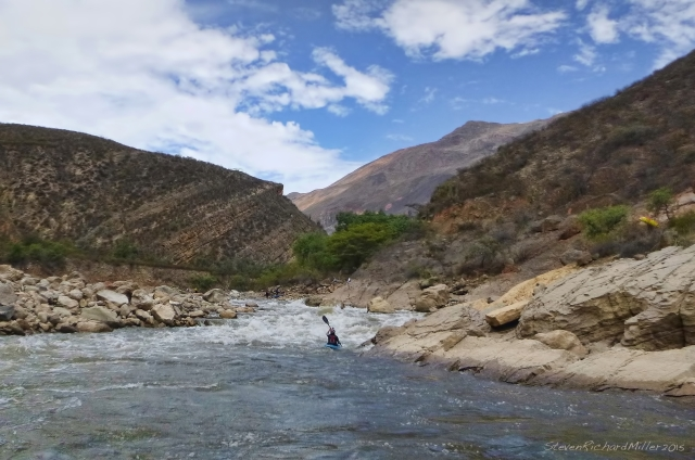 Jata Rapid. Pedro waits at the bottom, while Barba carries his kayak back to the top, to run the rapid again.