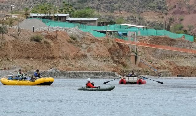 Bridge building. Karl, in his pack raft, is seen at center