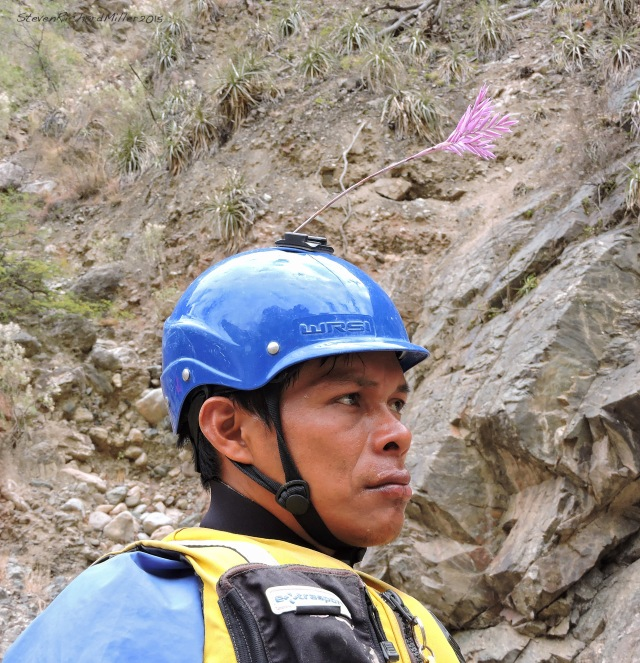 Zacarias , on the scout, with an orchid in his helmet. Later, he surprised us all by trying to swim across the top part of the rapid. Pedro came to his rescue, with a throw rope, to get him across the last channel.