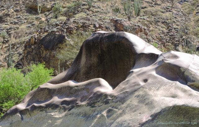 Fluted boulder