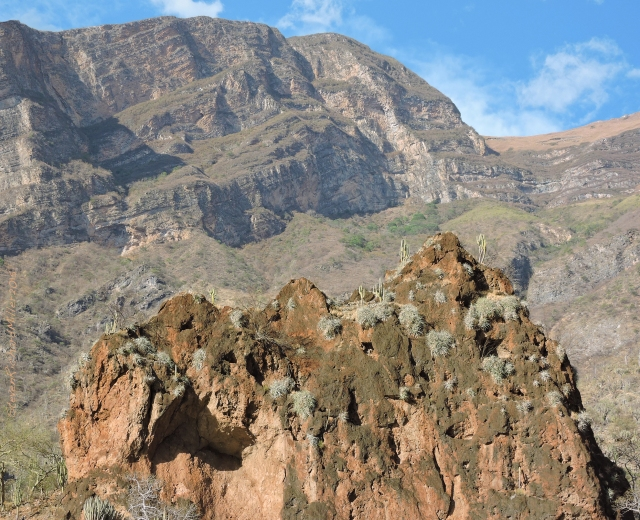 Eroded hill ()volcanic tuff) and view of the left lower side of Downstream view of Cerro Mataca Chica, 13,000'