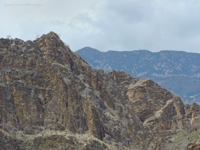 A rocky hill across the river, with the massive Cerro Ladera Grande behind. At 11,614', it rises 7,927' above the river. The altitude of the river at Calemar is 3,687'.