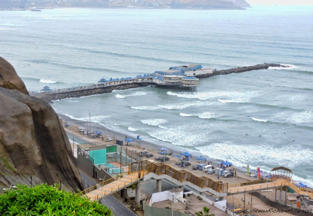 Surfers and Rosa Nautica, at Miraflores Beach