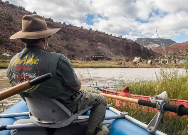Here I sit in our raft, across the Chama River from the set. I was awaiting a river crossing shoot.