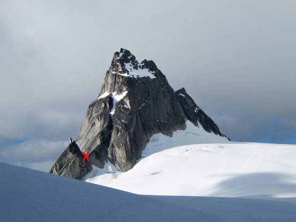 "Pigeon Spire. The NE Ridge climb starts at the Pigeon Toe col, which is marked with a red ""X"""