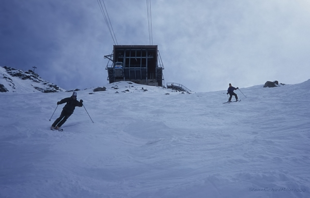 Skiing the steep face below the top terminal at Mont Fort