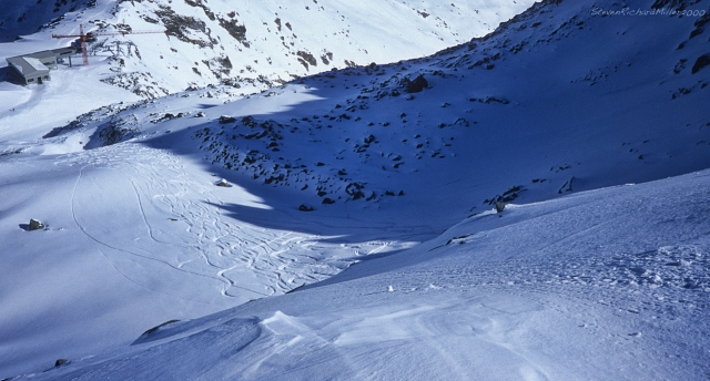 Skiing a steep slope off Mt. Gele, to the top of the Chassour gondola