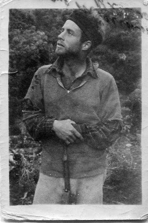 Baxter Dye, with rifle, in New Zealand