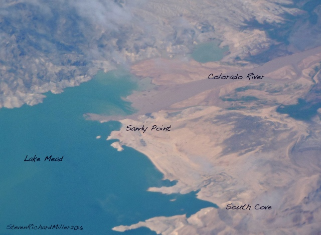 We flew over Las Vegas, allowing me to get this shot of the head of Lake Mead. This is of interest to me because it shows how Lake Mead is lowering in surface elevation and, thus, receding from areas formerly under water. It also shows the filling of the upper reaches of the lake with sediment delivered by the Colorado River