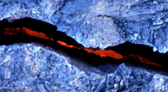 Glowing lava within the crack, at the edge of the flow