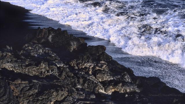 Shoreline, lava flow and surf