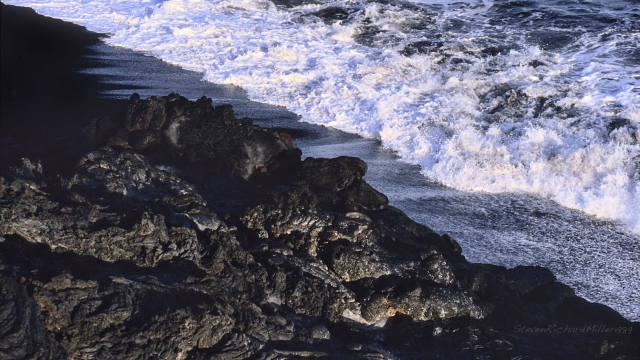 Shoreline, lava flow and surf