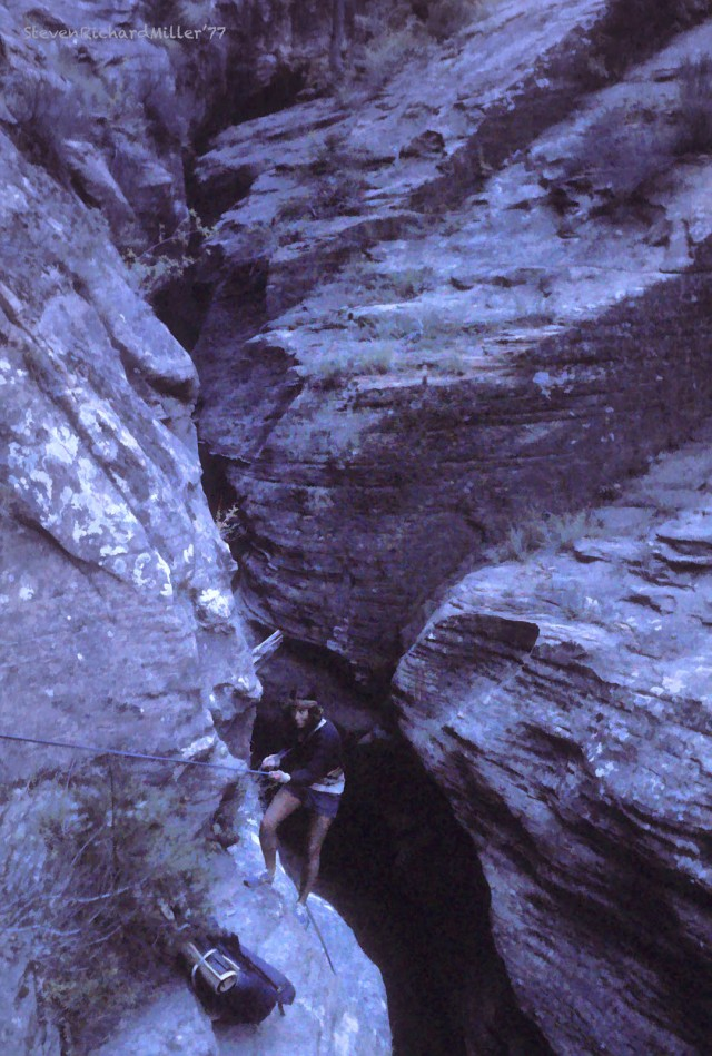 Rappelling into the bed of the canyon