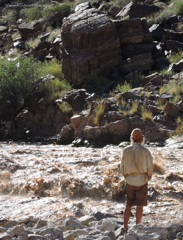Britt, scouting Granite Springs Rapid. Remember his clean white shirt, on Day 1? Well ... he never took it off the entire trip, and look at it now. He burned it that night.
